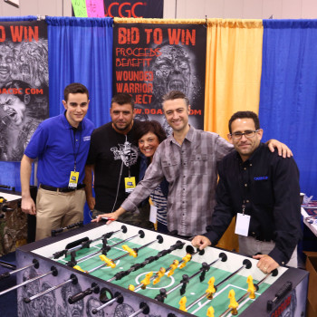 "Actor Sean Gunn from ""Guardians of the Galaxy"" and ""Gilmore Girls"" poses with the Carrom Co. crew after signing the table."