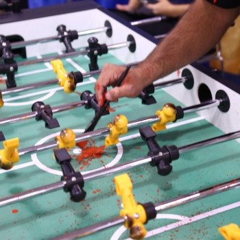 LA-based comic book artist Matt Jacobs adds realistic blood splatters to the zombie foosball table.