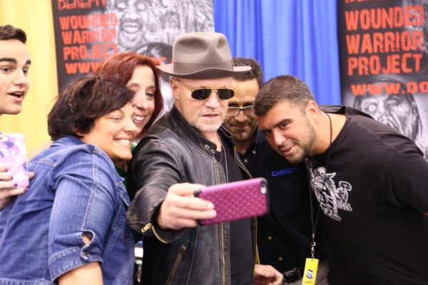 """The Walking Dead's"" Michael Rooker takes a selfie with fans after signing the foosball table."