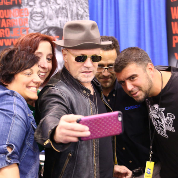 """""""The Walking Dead's"""" Michael Rooker takes a selfie with fans after signing the foosball table."""